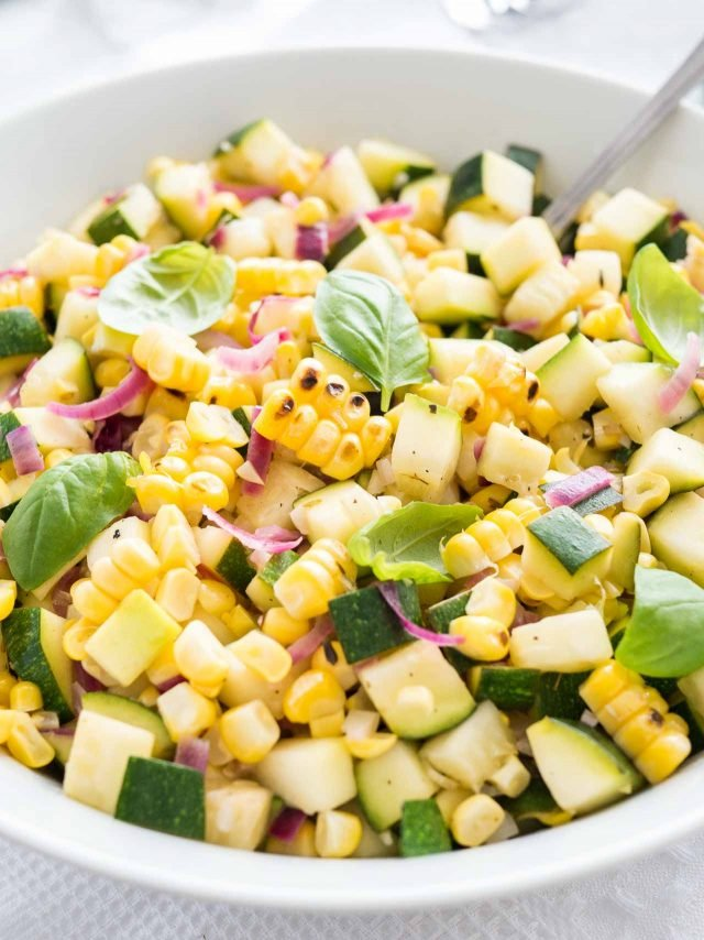 Summer vegetable side dish made with fresh corn, zucchini, and onions