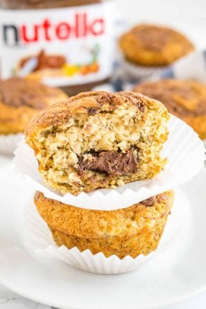 Banana Nutella Muffins are so easy and quick to make from scratch! A fluffy bakery-style Banana Muffin filled with Nutella that makes a great snack or breakfast.