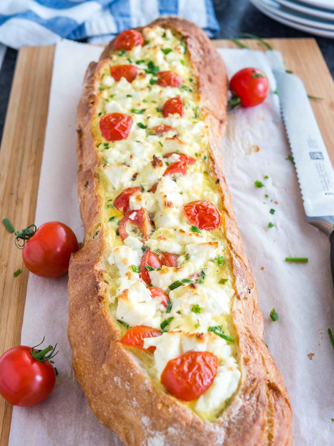 Bread Boats are a great party appetizer and super easy to make! This one is stuffed with tomatoes and feta cheese.