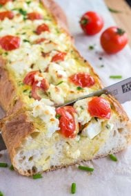 Tomato Feta Stuffed French Bread is so easy to make and bursting with fresh flavors! This is the ultimate appetizer for your next party!
