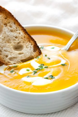 This Creamy Butternut Squash Soup is a great winter warmer and so easy to make! You can make this simple but so flavorful soup in your crock pot, Instant Pot or on the stove. A delicious healthier soup recipe that's the perfect comfort food for a cozy winter day!