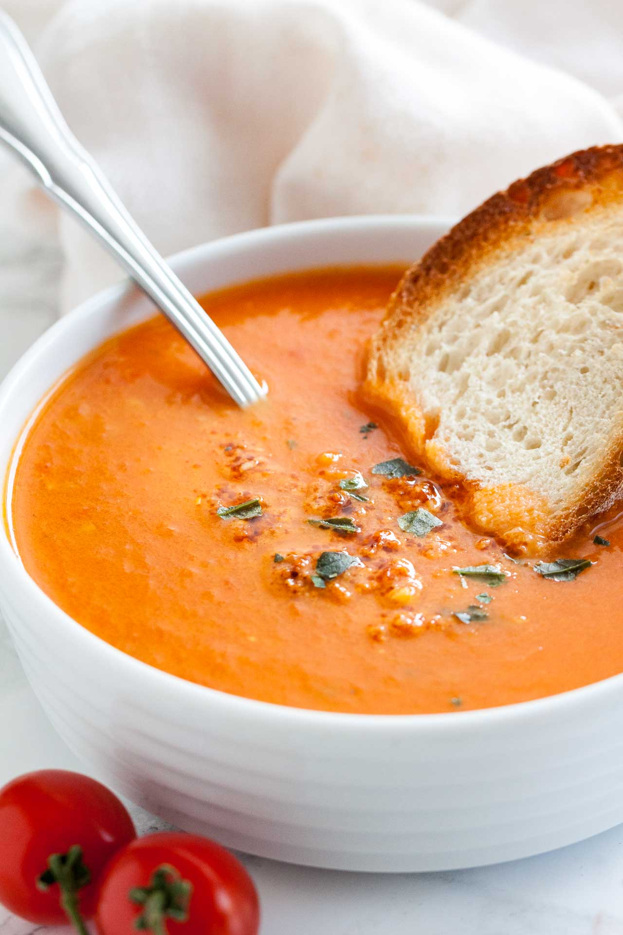 Creamy Roasted Tomato Soup With Basil Plated Cravings