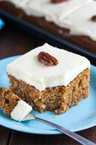 This Pumpkin Spice Cake is moist, tender, and so easy to make from scratch! With the perfect balance of pumpkin flavor and spices, this simple sheet cake is one of the best pumpkin cakes you'll ever eat.
