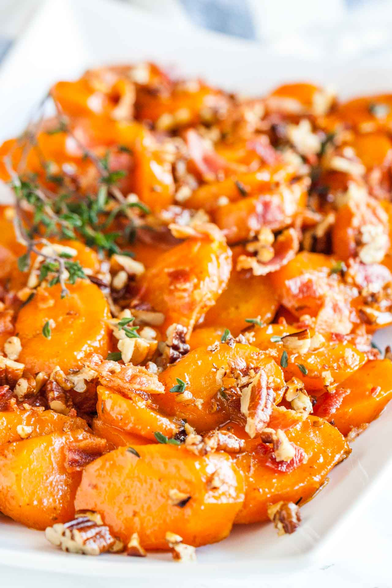 Glazed carrots - an easy vegetable side dish with bacon and pecans