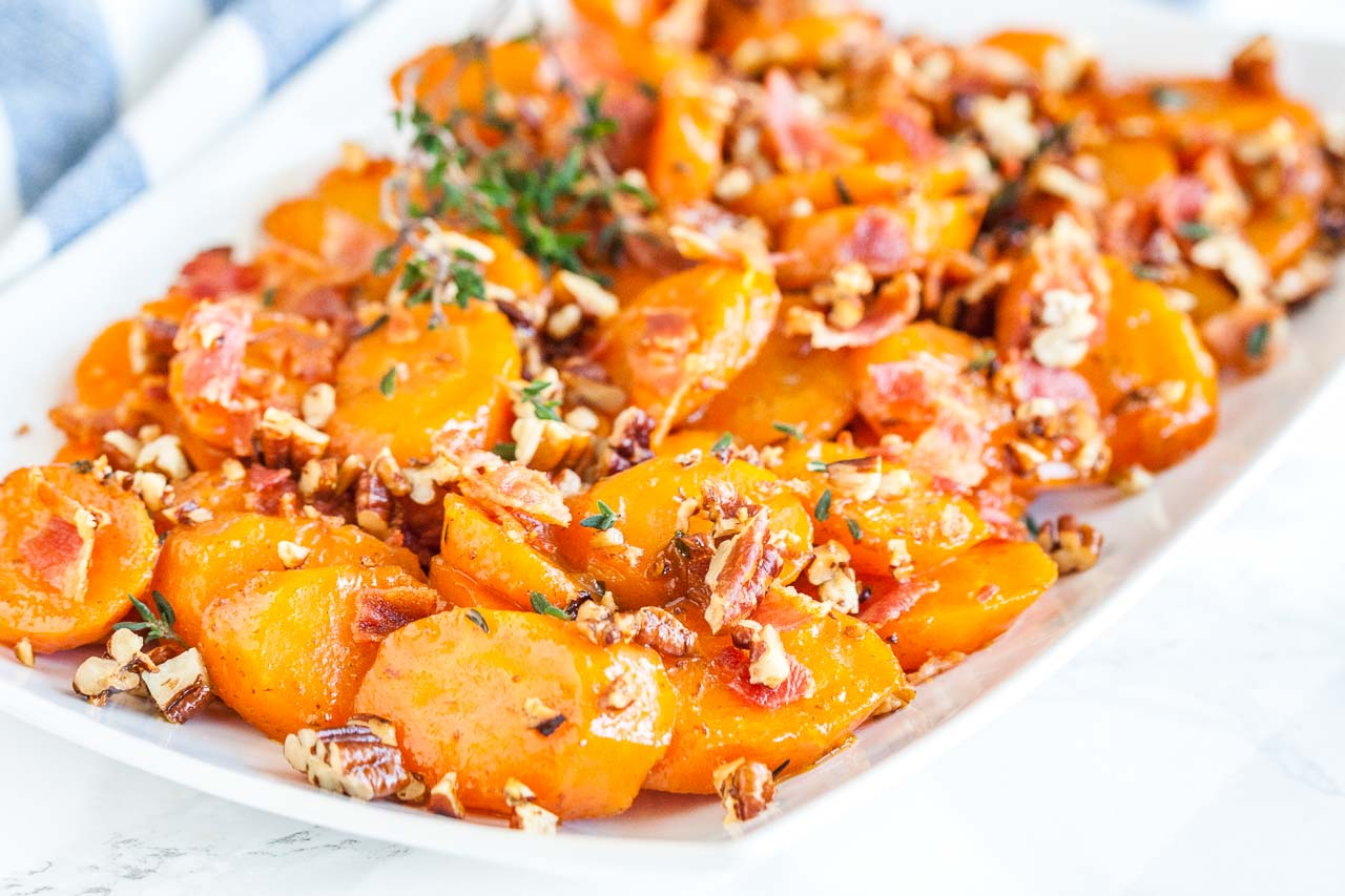 Easy brown sugar glazed carrots with bacon and pecans. A perfect side dish for the holidays!