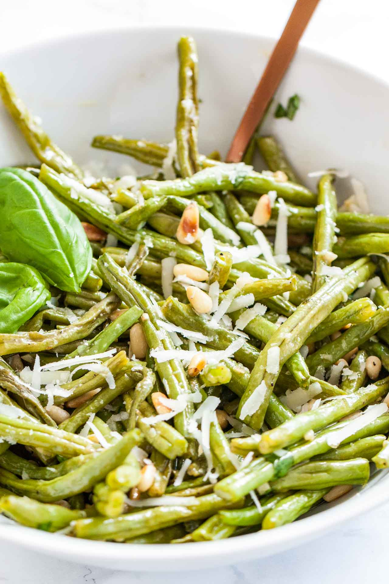 Parmesan Oven Roasted Green Beans are the perfect side dish for holidays or family dinners! Roasted in the oven to perfection, tossed with a flavorful lemon vinaigrette and sprinkled with parmesan and pine nuts, this easy dish is the most delicious way to enjoy fresh green beans.