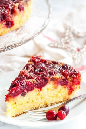 Cranberry Upside Down Cake has a perfectly balanced flavor and looks so festive and vibrant. A gorgeous cake made with fresh cranberries that's perfect for the holidays!