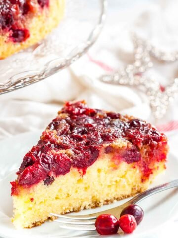 Cranberry Upside Down Cake has a perfectly balanced flavor and looks so festive and vibrant. A gorgeous cake made withfresh cranberries that's perfect for the holidays!
