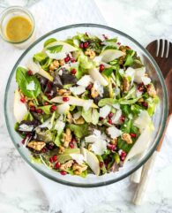 This Autumn Salad with Pear, Walnuts, and Pomegranate Seeds is easy to make , vibrant, and loaded with fresh flavors! A perfect salad for Thanksgiving and Christmas.
