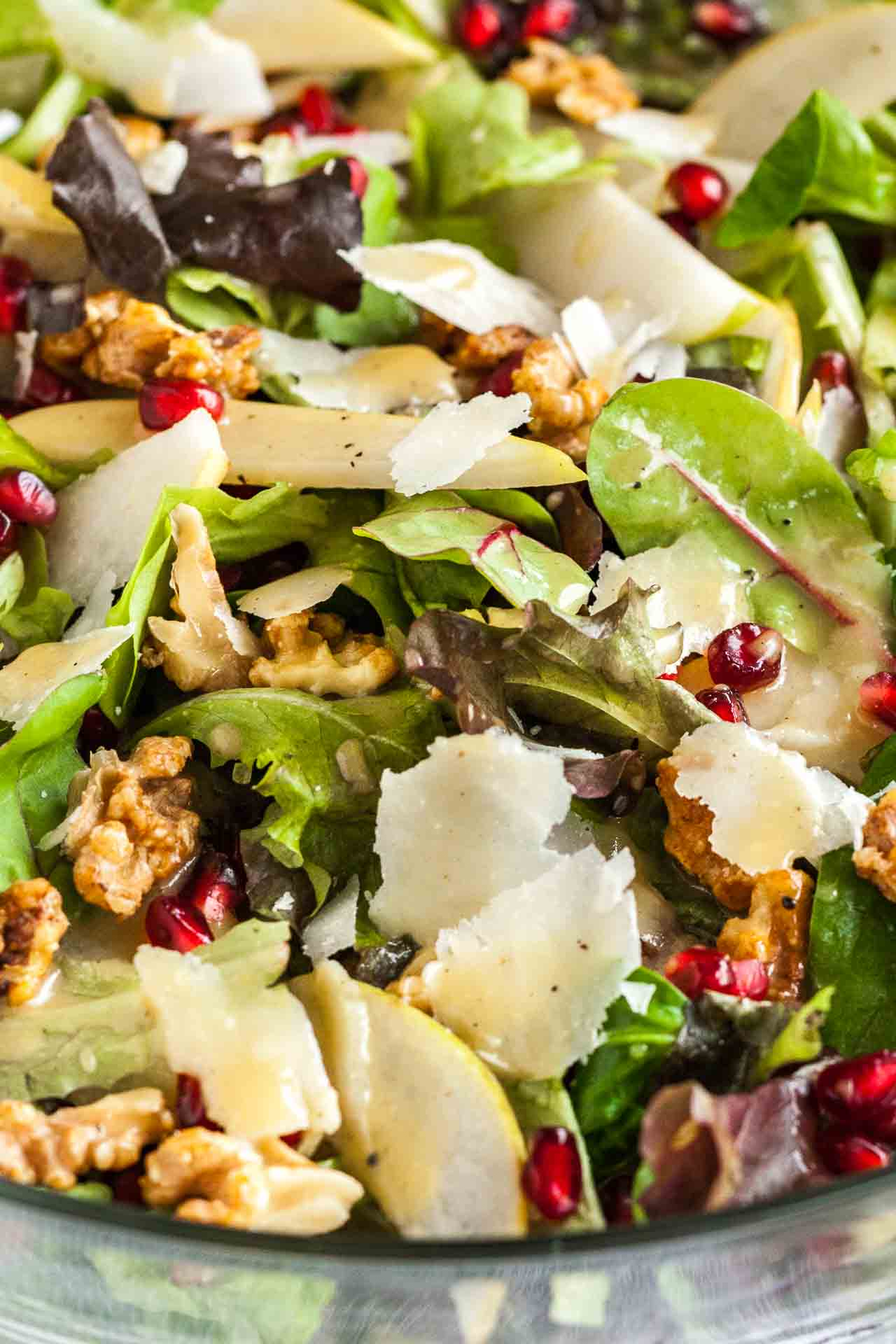 Pear Pomegranate Salad with Walnuts is loaded with flavors and different textures! A vibrant and delicious addition to your Holiday dinner table.