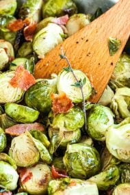 Roasted Brussels Sprouts with Bacon are so easy to make with just a few simple ingredients but are so flavorful! Roasted in the oven to perfection and tossed with crispy bacon, this easy side dish is perfect for a holiday meal.