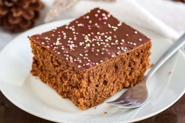 This easy Spice Cake Recipeis an old family recipe and makes your house smell amazing! A moist and chocolatey spiced sheet cake made with holiday spices that is easy to make from scratch and tastes even better on the next day.