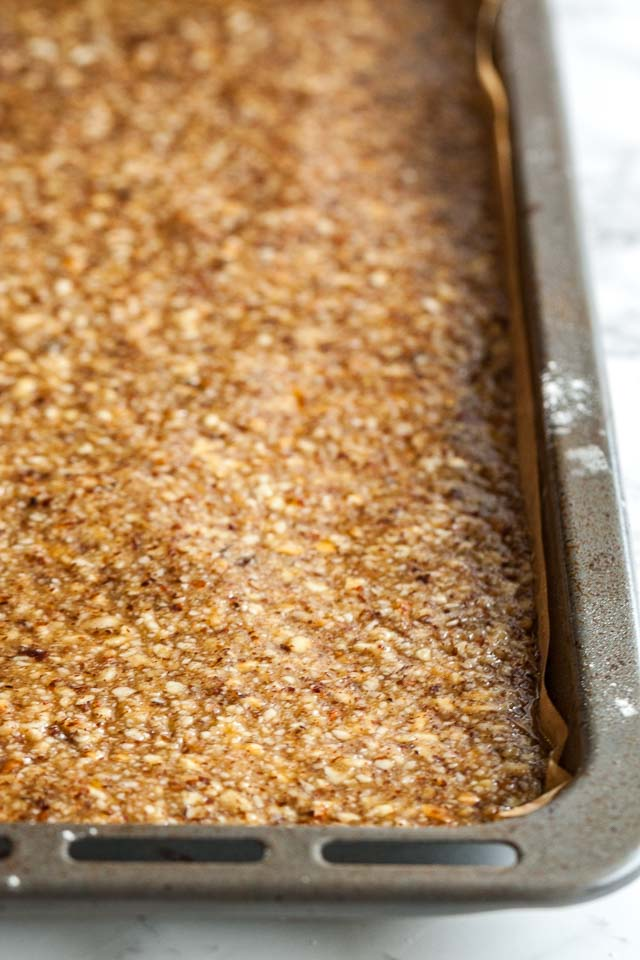 The buttery shortbread is followed by a layer of apricot jam and then topped with the nut mixture.