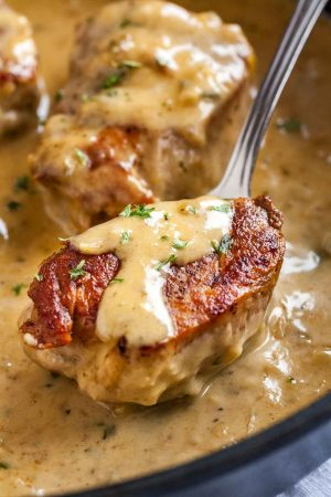 Pork Medallions with Blue Cheese Sauce make a delicious one-pan weeknight dinner that's on the table in 30 minutes! Fancy enough for a date night but so easy to make even if you aren't totally kitchen confident.