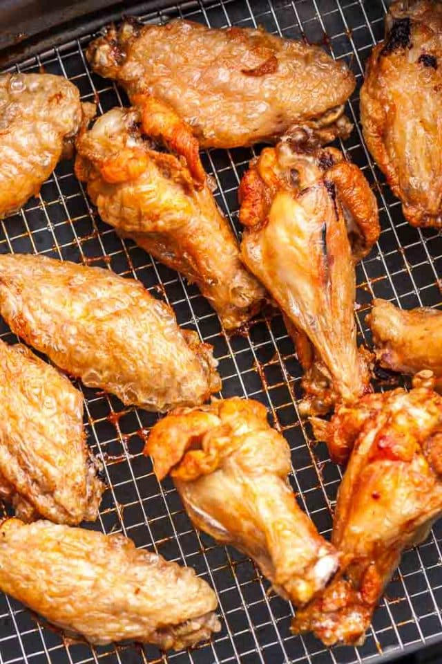 Chicken wings in an Air Fryer basket