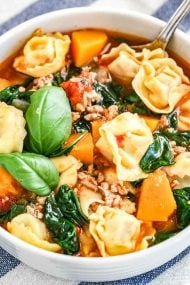 A comforting bowl of soup made with fresh basil, Italian Sausage, and Spinach
