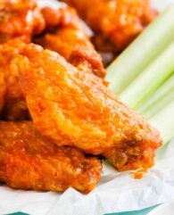 Buffalo Chicken Wings on a plate with celery sticks