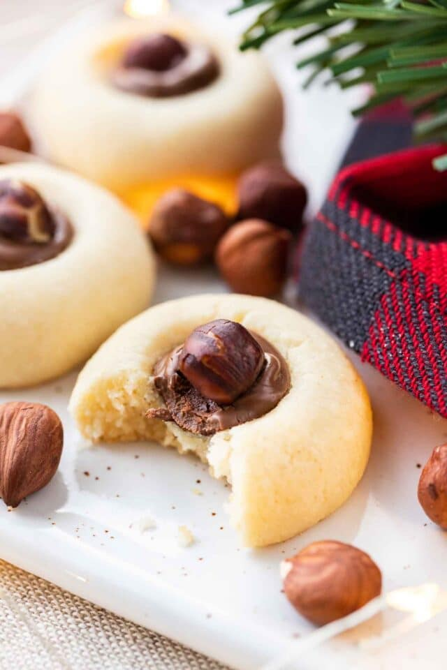 Cookies filled with Nutella and whole hazelnuts on a serving platter