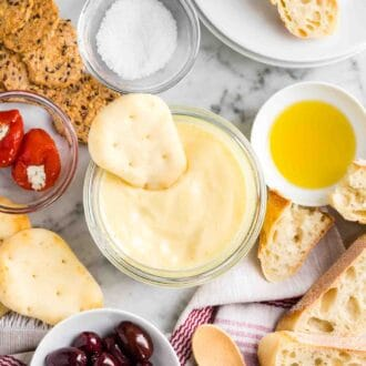 Aioli, bread, olives, and antipasti on a table
