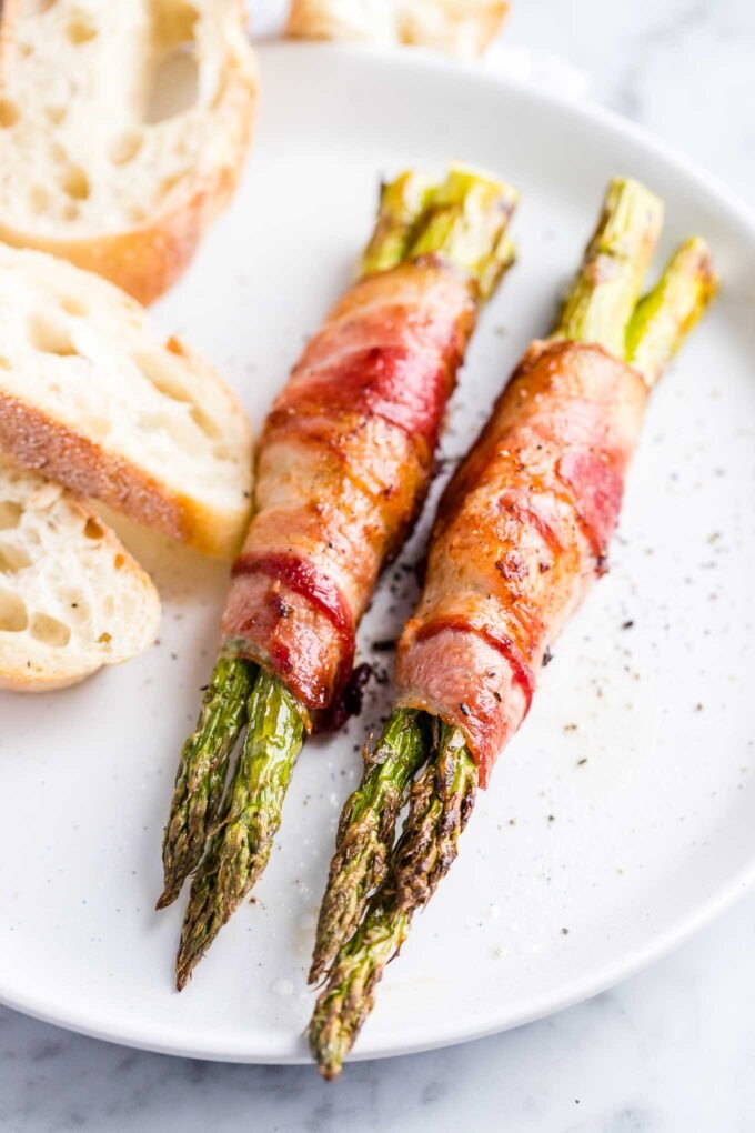 Asparagus wrapped in bacon on a plate