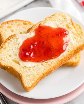 Sliced Brioche Bread on a plate with jam