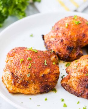 Air fried chicken thighs on a plate