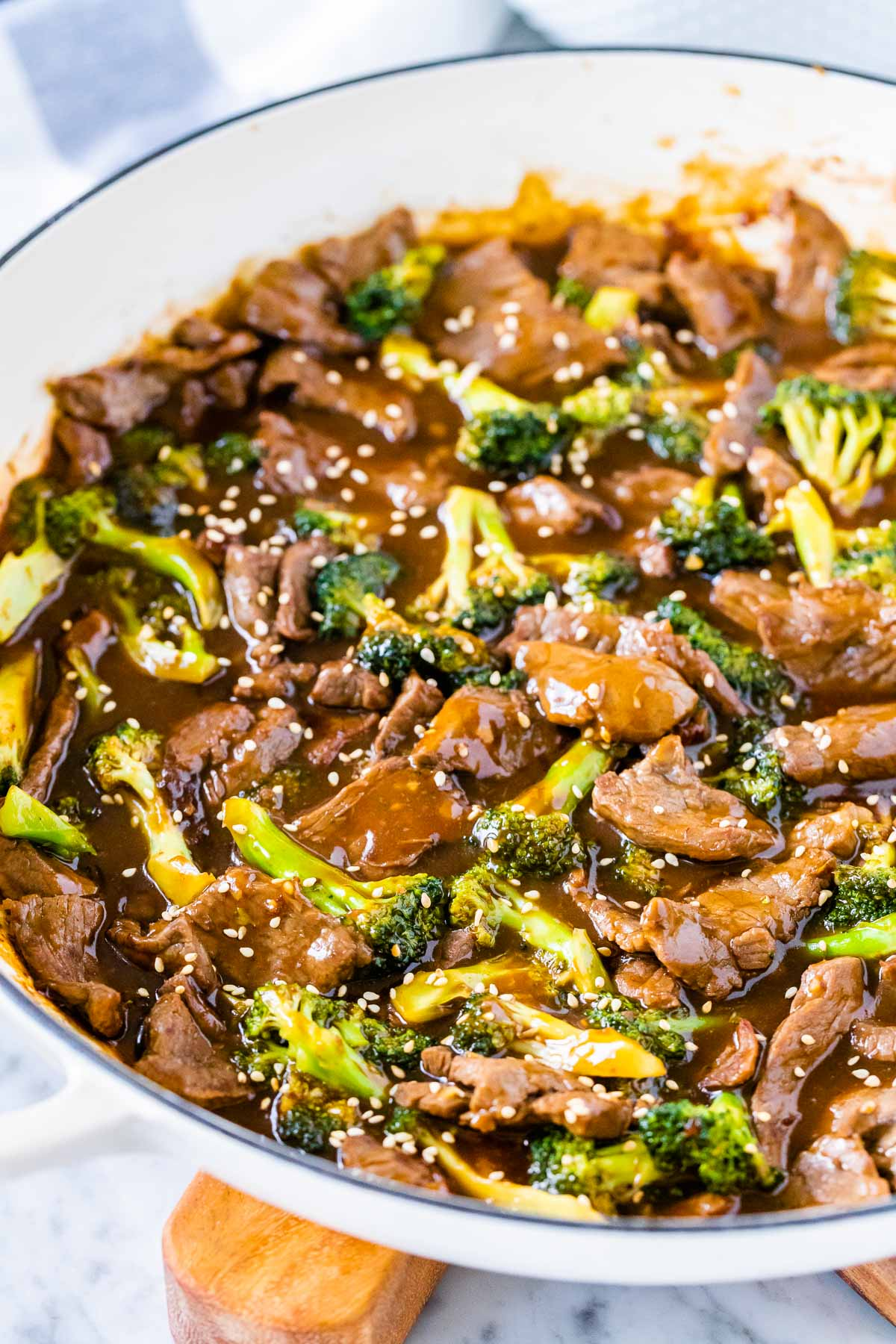 Beef and broccoli stir fry in a white pan