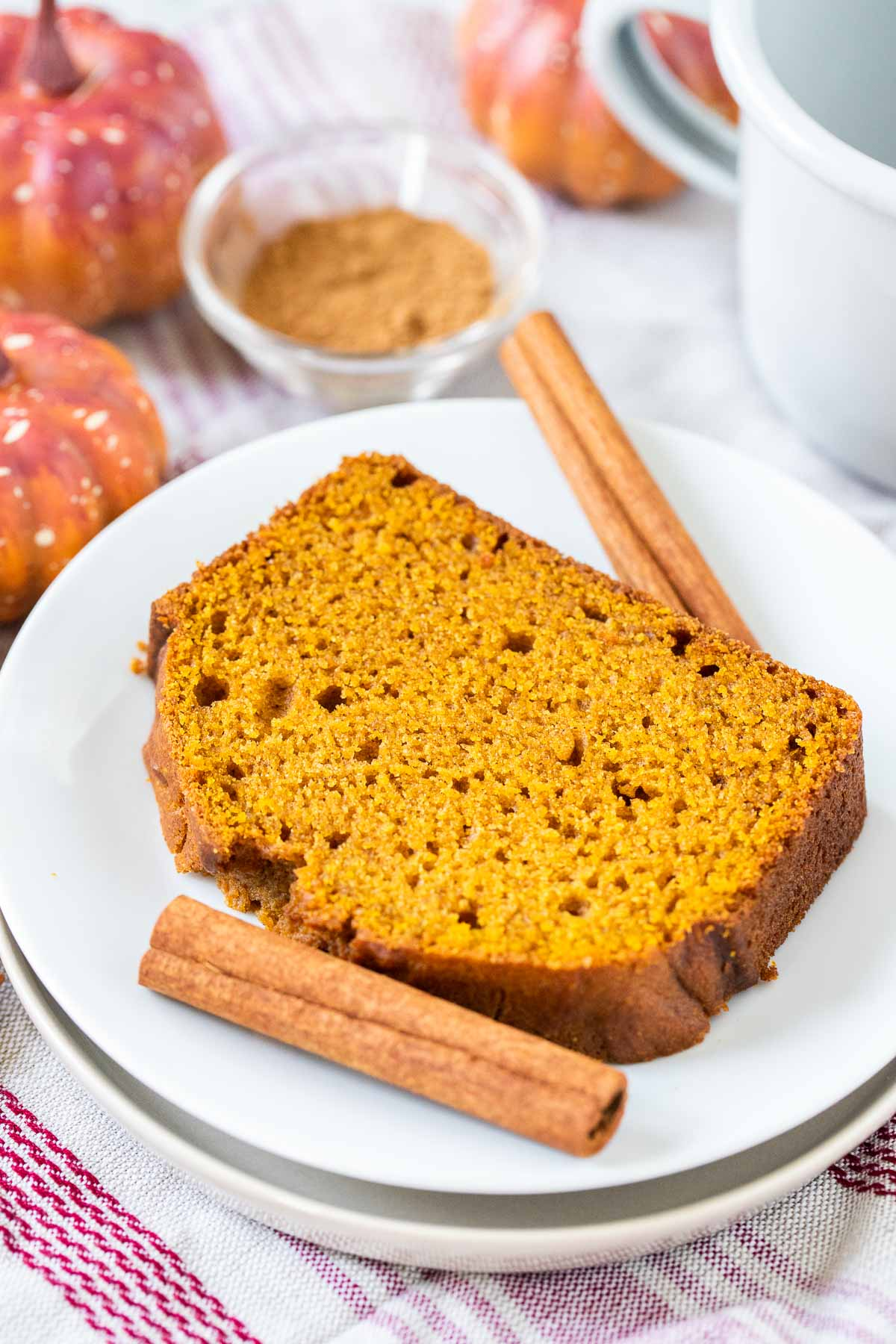 A slice of pumpkin bread on a plate