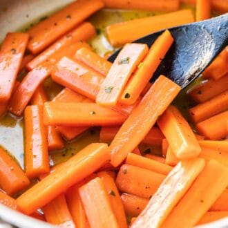 Carrots in a large skillet glazed with honey