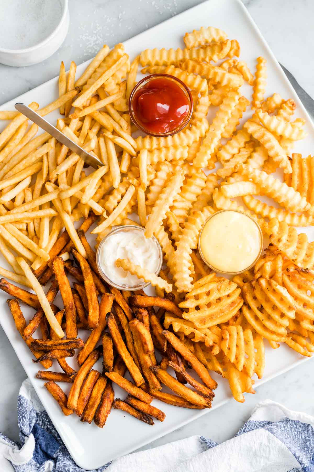 Air Fryer French Fries on a white plate served with dips