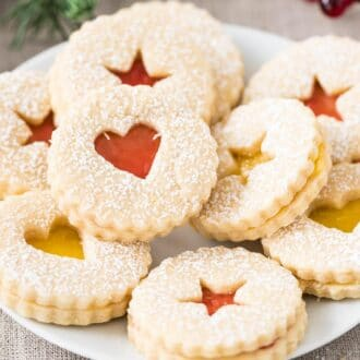 Linzer Cookies stacked on a plate