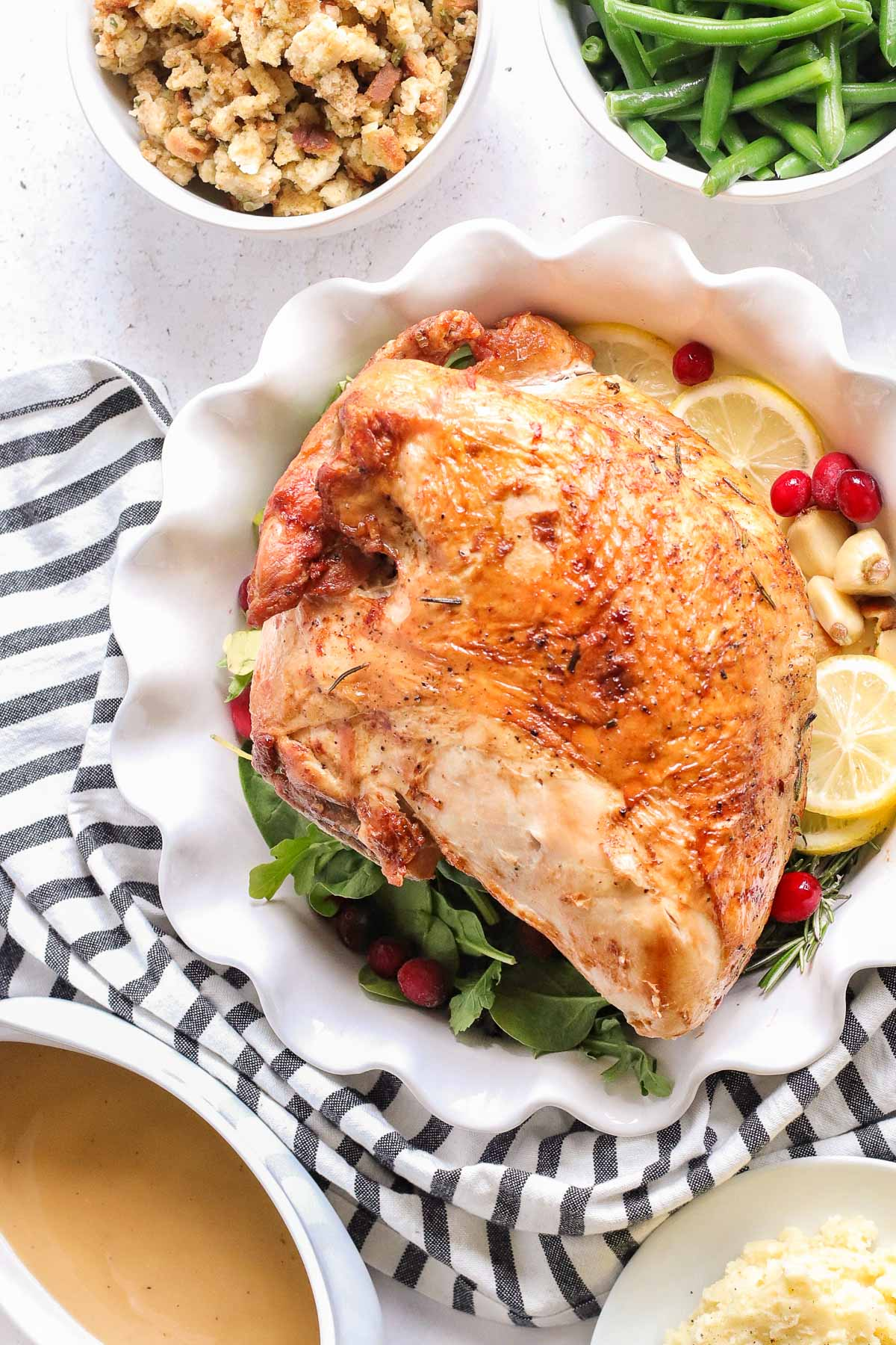 A roasted turkey breast on a serving platter